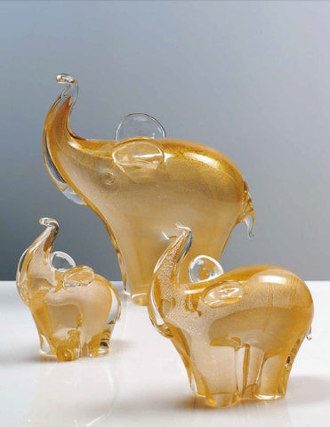 Family of three elephants with gold