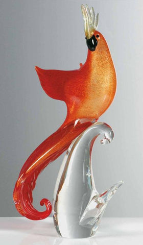 Red and gold parrot on a crystal base