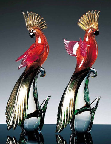 Pair of red and gold parrots with long tailfeathers