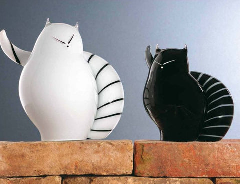 Modern white and black cats with striped tails