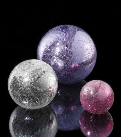 Spheres in crystal, ruby and violet glass