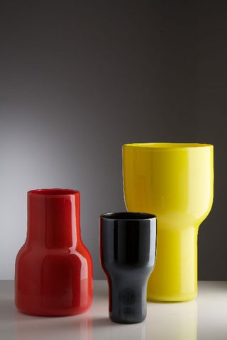 Asymmetric vases in coral, black and yellow