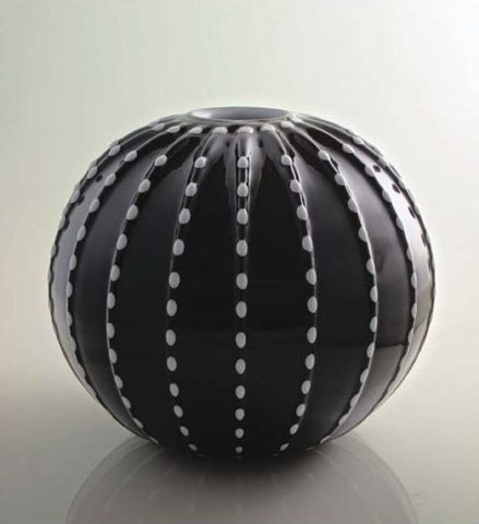 Black spherical vase with contrasting colour