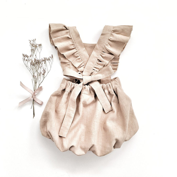 The Ari Ruffled Romper in Dark Wheat