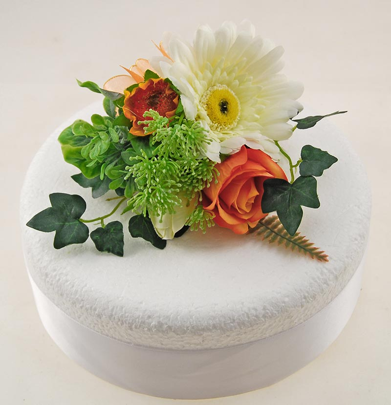 Ivory Silk Gerbera, Orange Silk Rose & Mixed Green Foliage Wedding Cake Spray