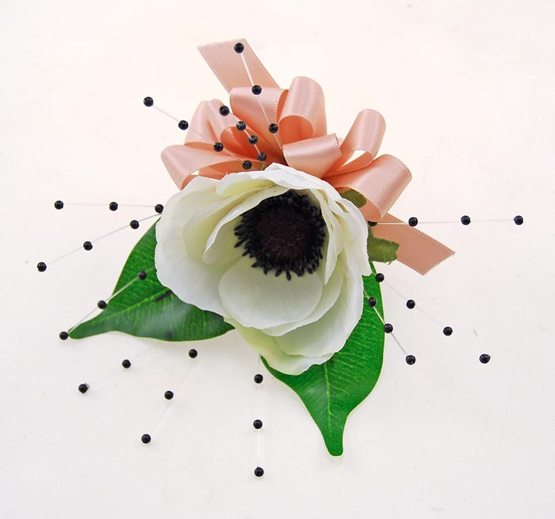 SILK IVORY ANEMONE WEDDING GUEST BUTTONHOLE WITH BLACK PEARLS
