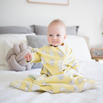 The Hands In & Out sleepsack for gentle swaddle transitioning, has a two-way zipper, top and bottom opening for easy diaper changes and a roomy, hip-friendly design, accommodates a hip-dysplasia brace.