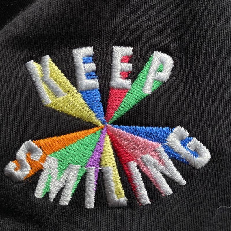 Keep Smiling Embroidered T-Shirt in Black