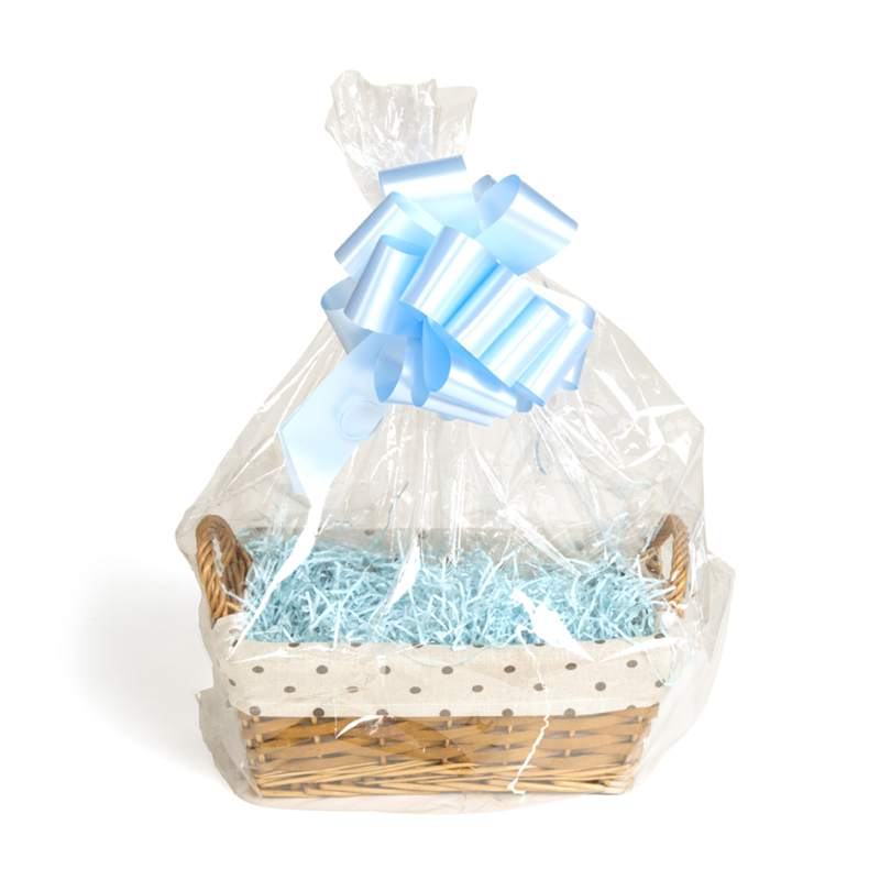 A basket with blue shred wrapped in cellophane with a blue bow