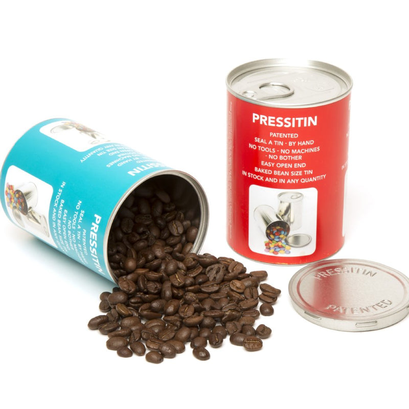 Two labelled Pressitins, one with coffee beans spilling out