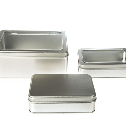 A collection of large silver rectangular tins with window or solid lids
