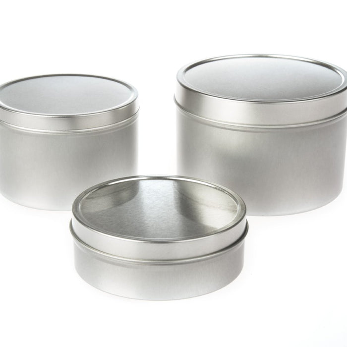 Collection of round seamless tins with solid slip lid