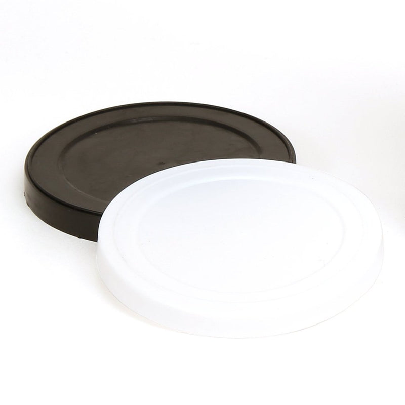 One white and one black Plastic Pressitin over cap