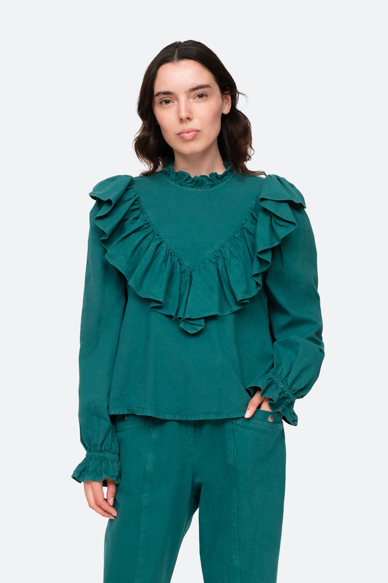 Forrest-Metta Blouse-Tucked Out Hand in Pocket View 1