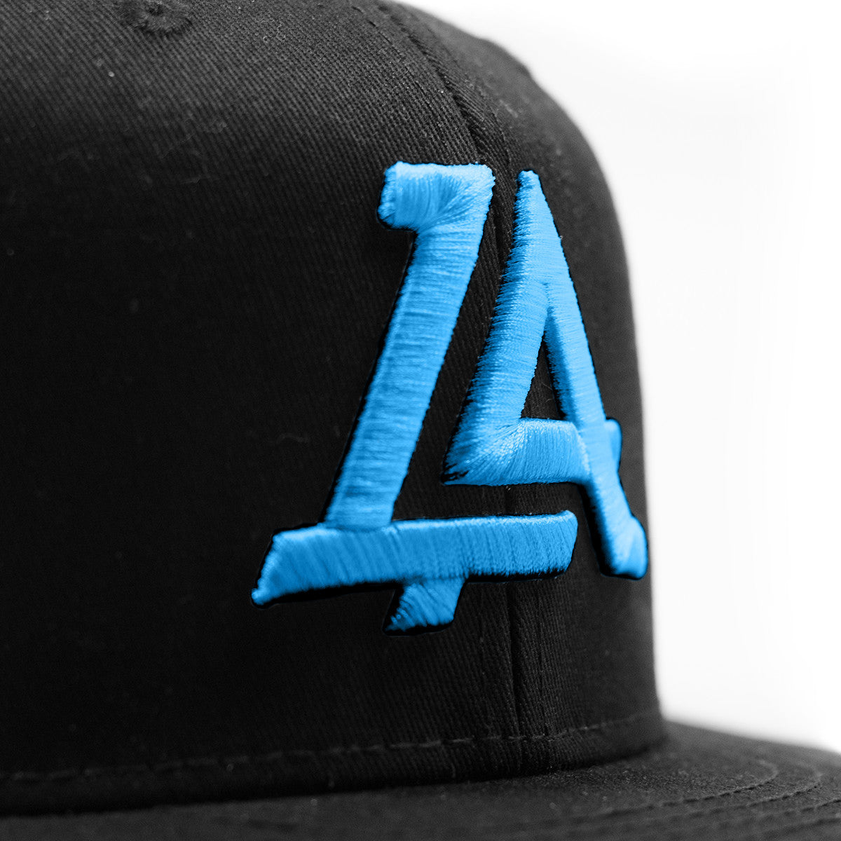 Lost Art Canada - blue logo black snapback hat close up