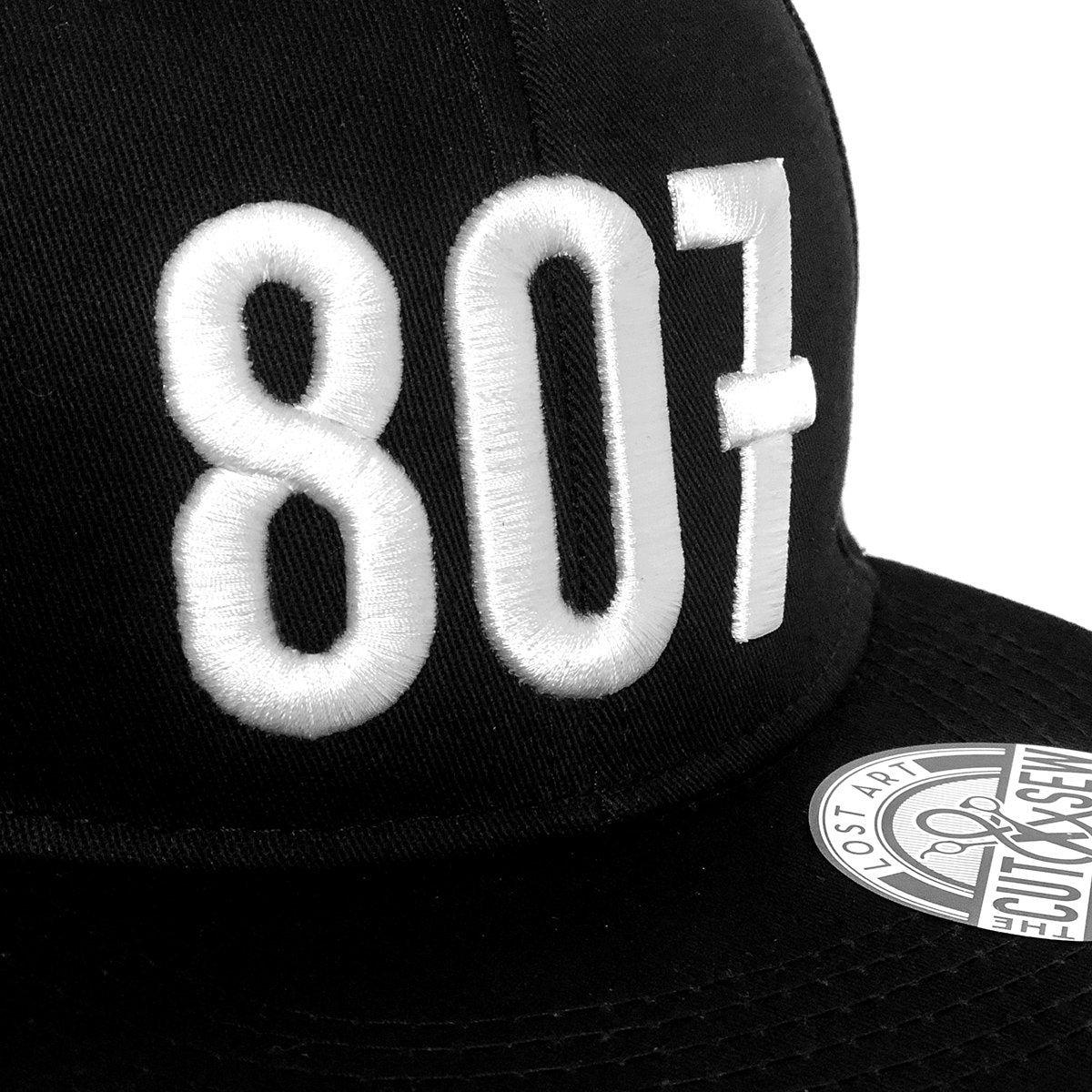 Lost Art Canada - white 807 black snapback hat close up