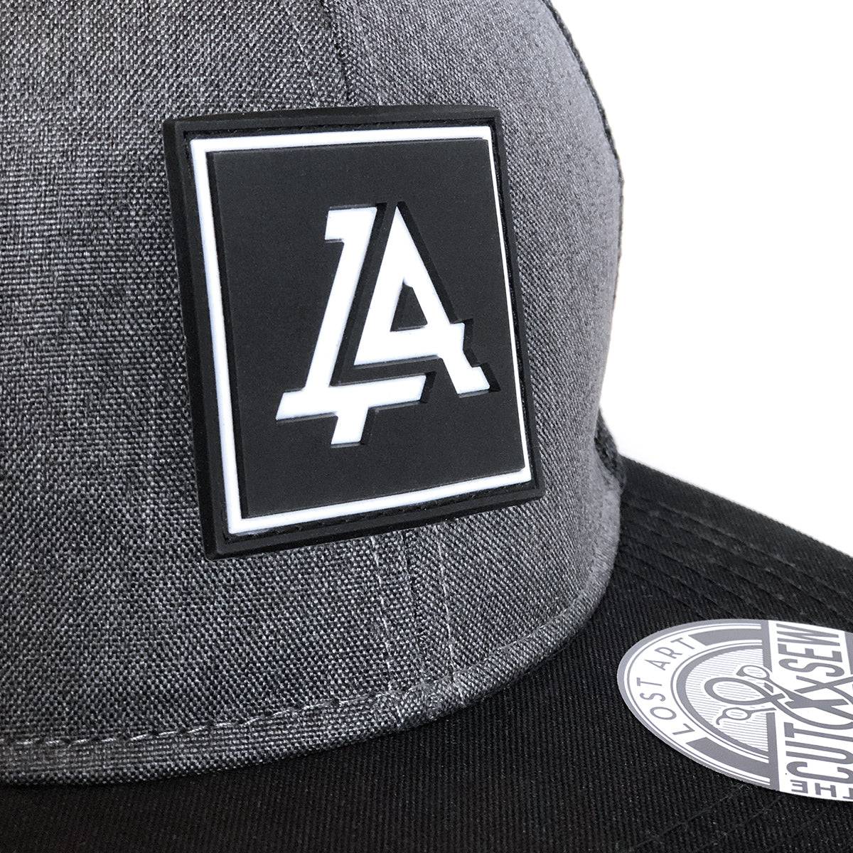 Lost Art Canada - grey and black patch snapback hat close up
