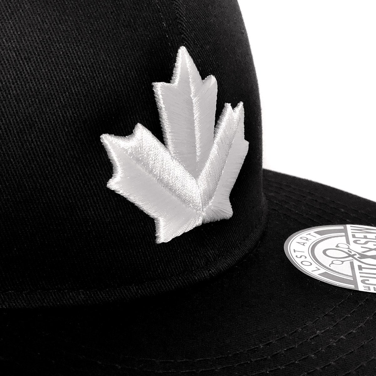 Lost Art Canada - white maple leaf black snapback hat close up