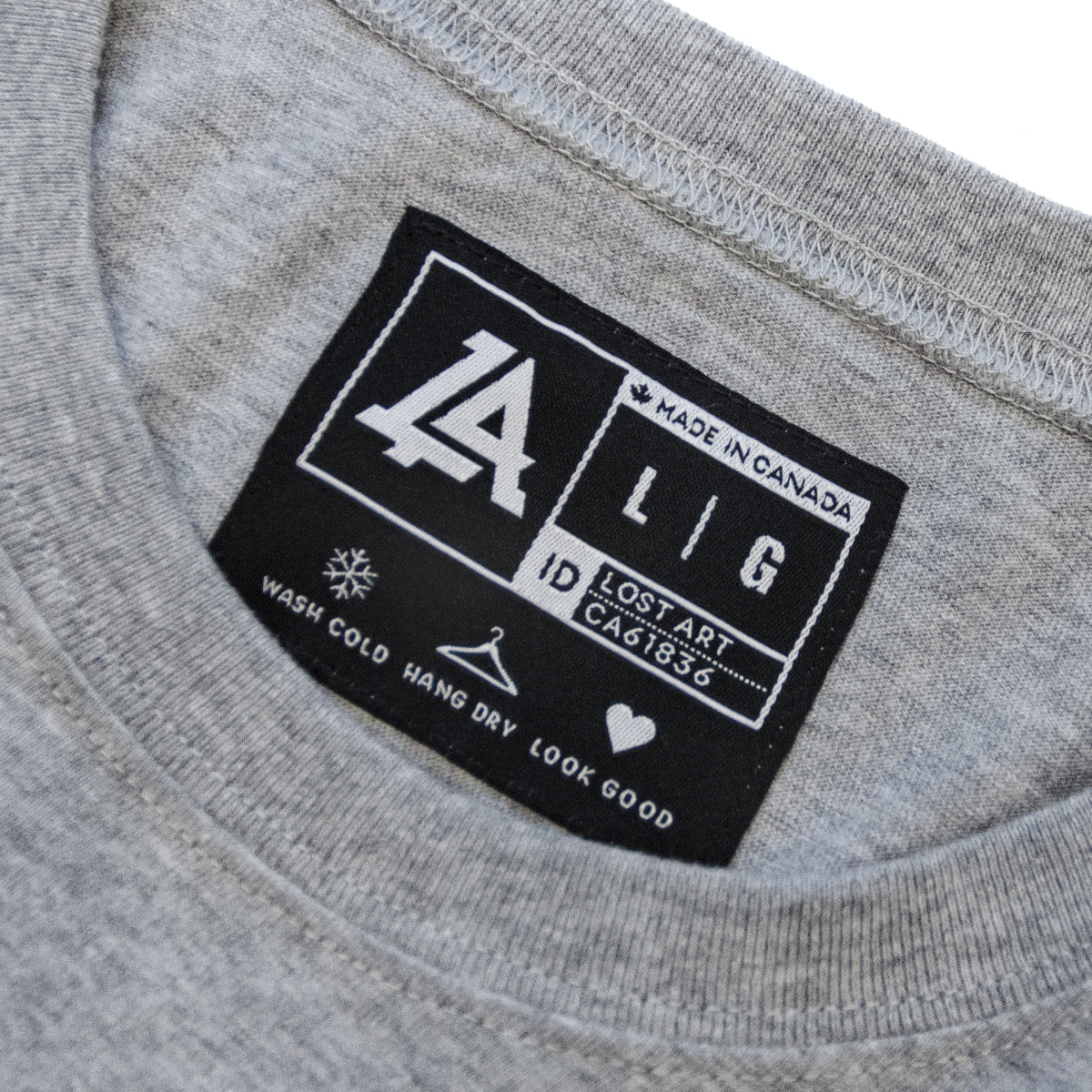 Lost Art Canada - white on grey basic women logo tee inside tag view
