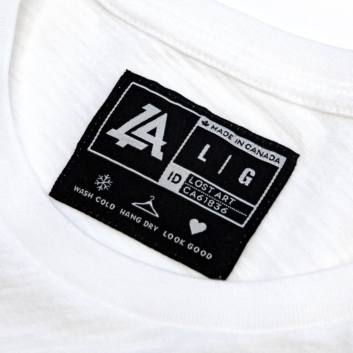 Lost Art Canada - white on white ghost logo tee inside tag view