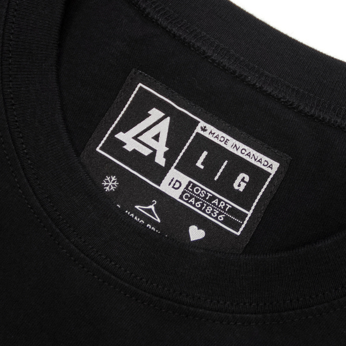 Lost Art Canada - white on black monogram logo tee inside tag view