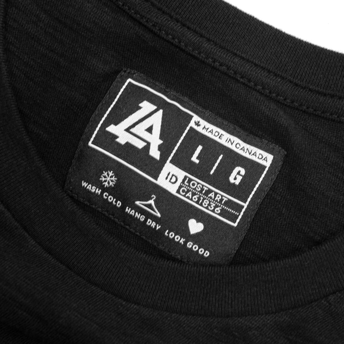 Lost Art Canada - black on black lost monogram tee inside tag view