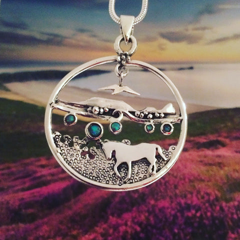 Worm's Headlandscape necklace with horse