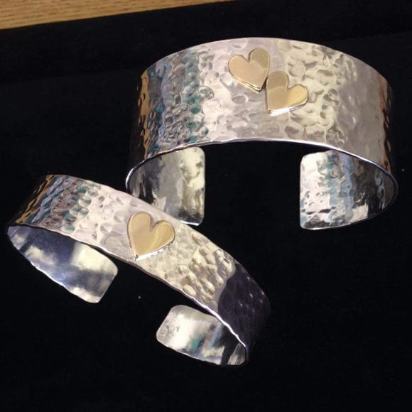 Silver textured cuff with gold hearts