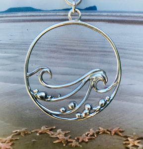 Wave and pebbles necklace