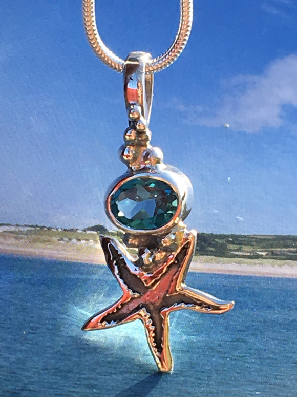 Silver starfish topaz necklace