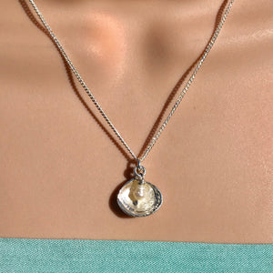 Silver shell necklace with pearl drop