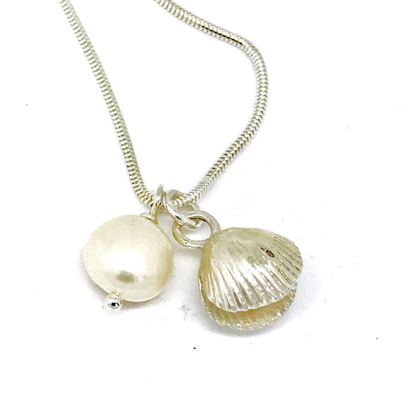 Silver double sided cockle shell and pearl necklace
