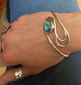 Swirling currents bangle cuff