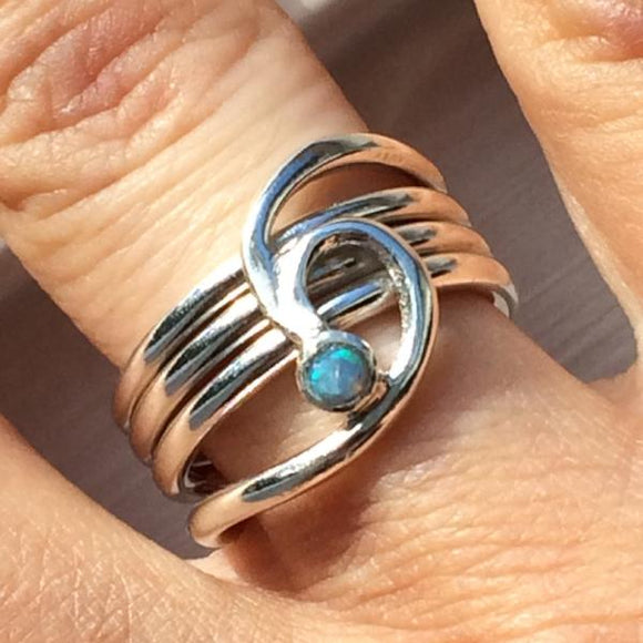 Silver barrelling wave and opal ring