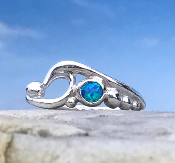 wave and pebbles ring with manmade opal