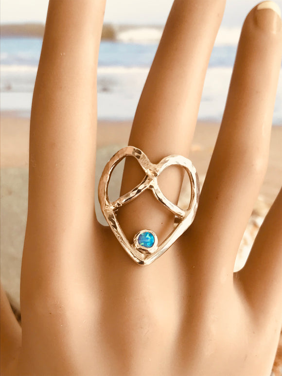 Heart crossover ring with opal