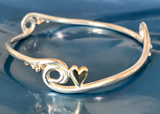 Silver and gold wave, pebbles and heart bangle