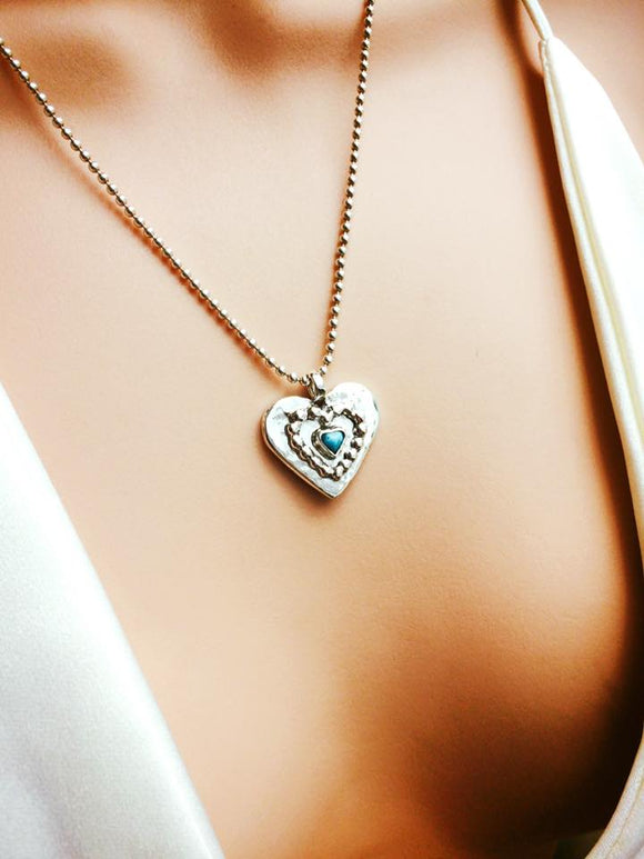 silver heart necklace with turquoise stone