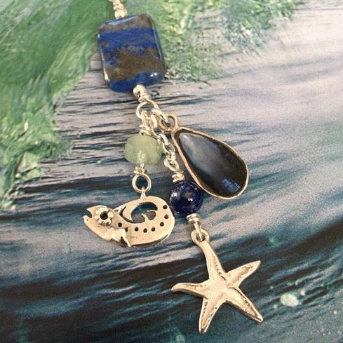 This is a unique solid silver starfish, baby real set blue mussel and baby bass necklace.