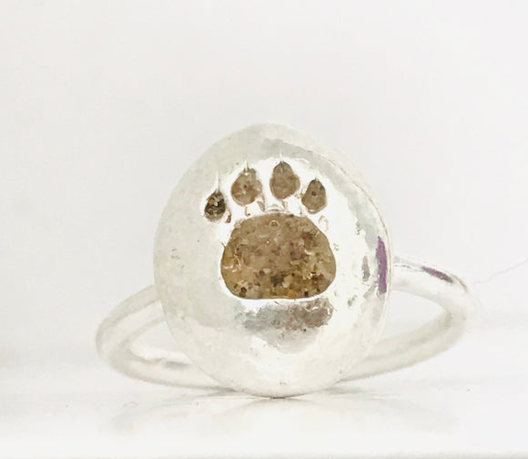 Paw print pebble ring with Gower sand inlay.