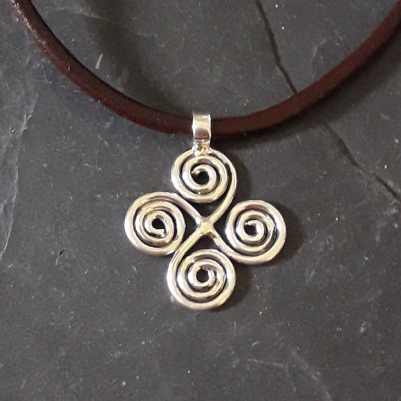Celtic silver pendant on brown leather