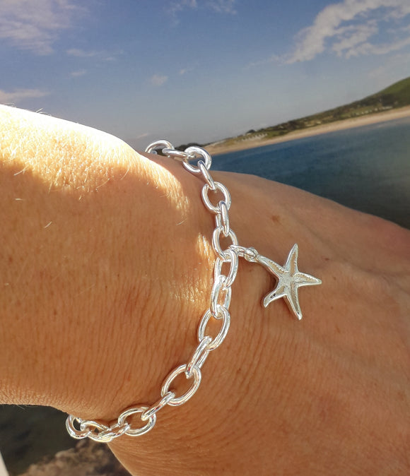 Silver charm bracelet with starfish