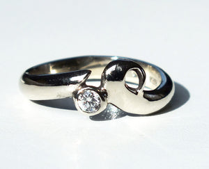 White gold and diamond wave ring