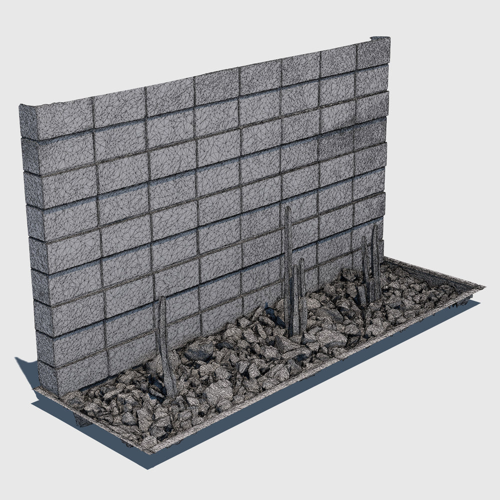 ground level planter full of medium sized rocks and 3 tall skinny cacti sections with a cement cinder block wall behind it rendered with medium resolution wireframe