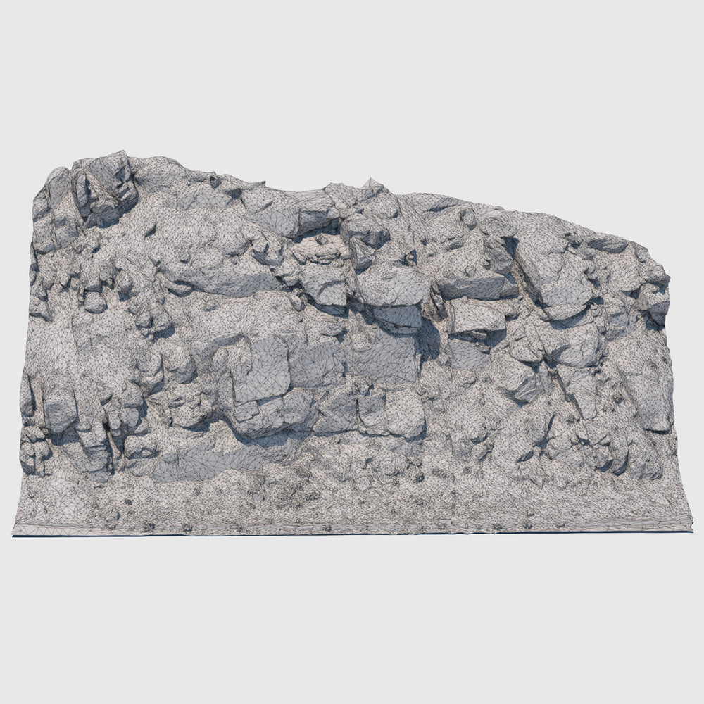 51' long cg rock formation that is approximately 23' tall and gray in color with lots of smaller rock debris and foilage at the base rendered in low resolution wireframe