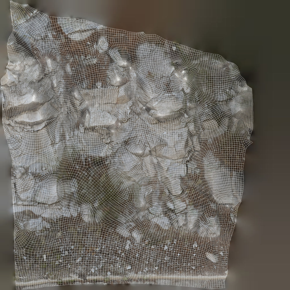 uv texture map of a large rock formation with lots of smaller rock debris at the base