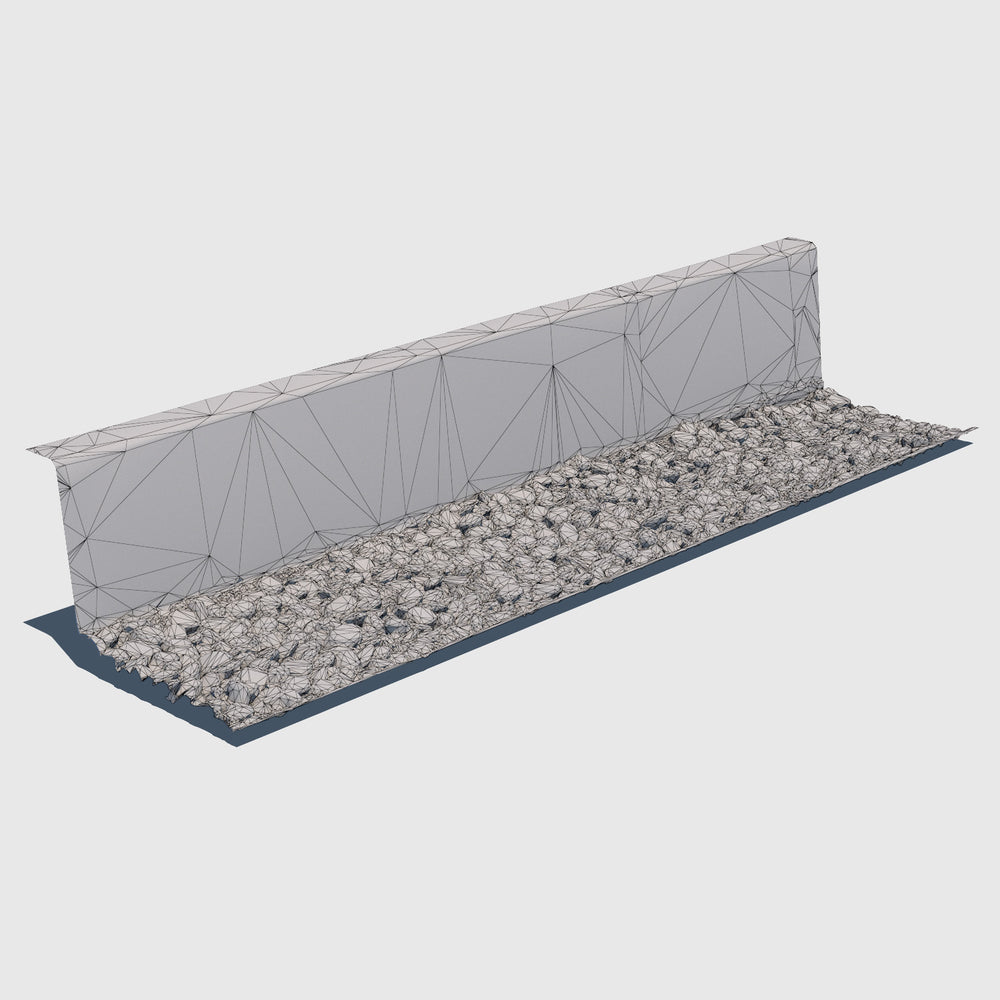 Short cement wall with a bed of blue river rocks at the base rendered with low resolution wireframe