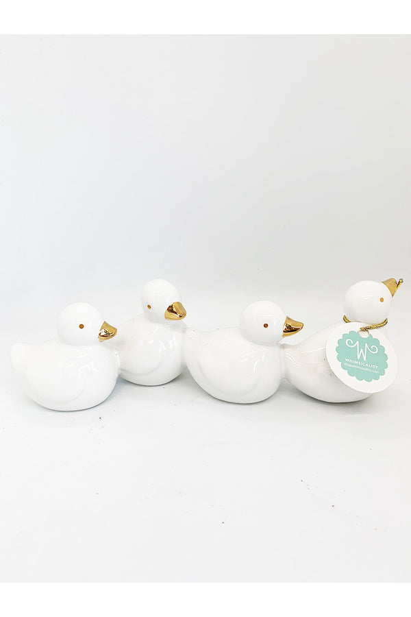 Four White Ducks Figure