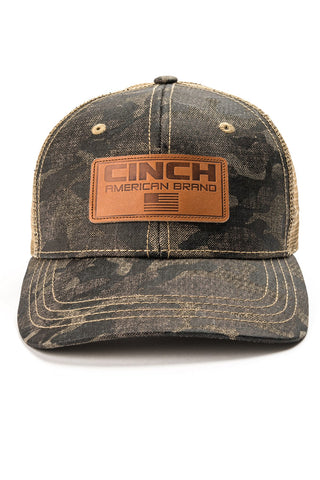 Mesh back trucker cap with tonal camo print on the bill and crown, and leather logo patch.
