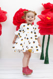 Frill sleeve twirl dress in Golden Acorns